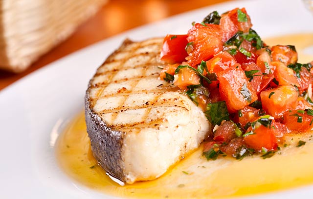 Baked fish with tomato garlic and mediterranean herbs for Mediterranean fish recipes
