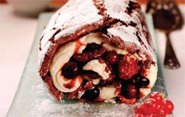 Chocolate Roulade with Spiced Berry Compote and Cointreau Cream