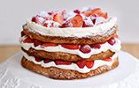 Hazelnut Meringue Layer Cake with Strawberries & Raspberries